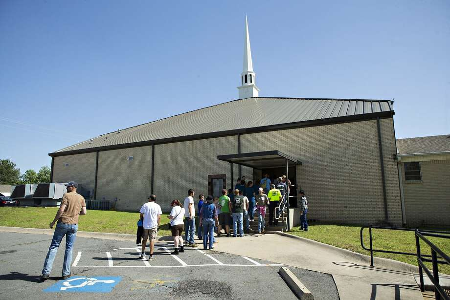Volunteers helping to clean up line up to sign in at Beryl Baptist Church after a tornado yesterday tore through the area for the second time in three years, on April 28, 2014 in Vilonia, Arkansas. After deadly tornadoes ripped through the region, leaving more than a dozen dead, Mississippi, Arkansas, Texas, Louisiana and Tennessee are all under watch as multiple storms over the next few days are expected.  Photo: Wesley Hitt, Getty Images