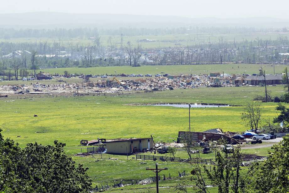 An elevated view shows damage along the path of a tornado that yesterday tore through the area for the second time in three years, on April 28, 2014 in Vilonia, Arkansas. After deadly tornadoes ripped through the region, leaving more than a dozen dead, Mississippi, Arkansas, Texas, Louisiana and Tennessee are all under watch as multiple storms over the next few days are expected.  Photo: Wesley Hitt, Getty Images