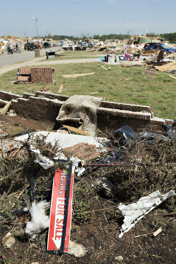 A For Sale sign lies in a destroyed neighborhood after a tornado yesterday tore through the area for the second time in three years, on April 28, 2014 in Vilonia, Arkansas. After deadly tornadoes ripped through the region, leaving more than a dozen dead, Mississippi, Arkansas, Texas, Louisiana and Tennessee are all under watch as multiple storms over the next few days are expected.  Photo: Wesley Hitt, Getty Images