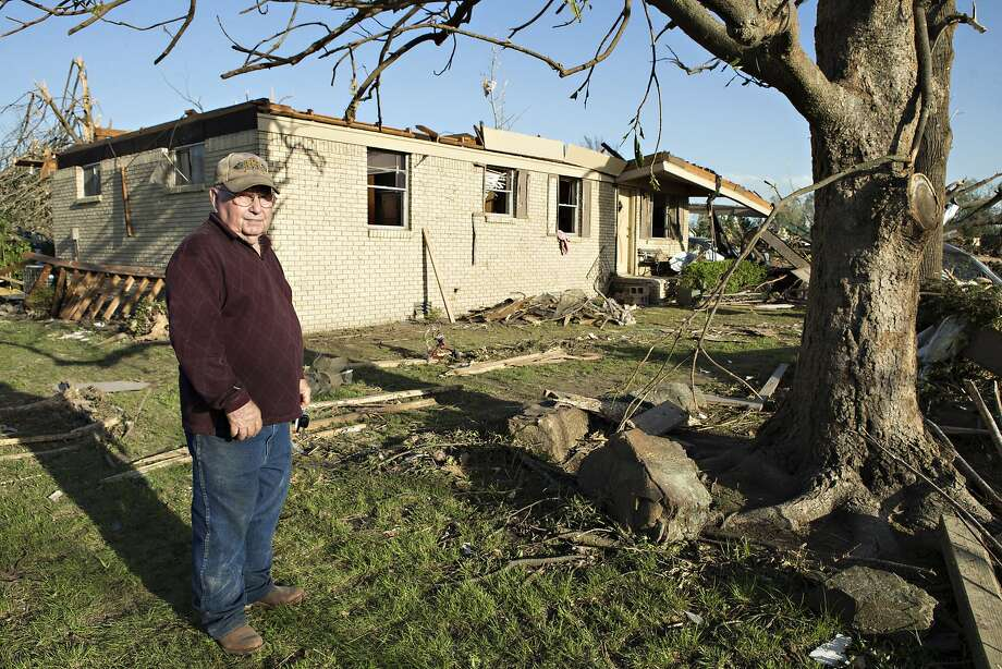 Robert Gubanski stands in front of his house that was destroyed by a tornado yesterday that tore through the area for the second time in three years, on April 28, 2014 in Mayflower, Arkansas. After deadly tornadoes ripped through the region leaving more than a dozen dead, Mississippi, Arkansas, Texas, Louisiana and Tennessee are all under watch as multiple storms over the next few days are expected. Photo: Wesley Hitt, Getty Images