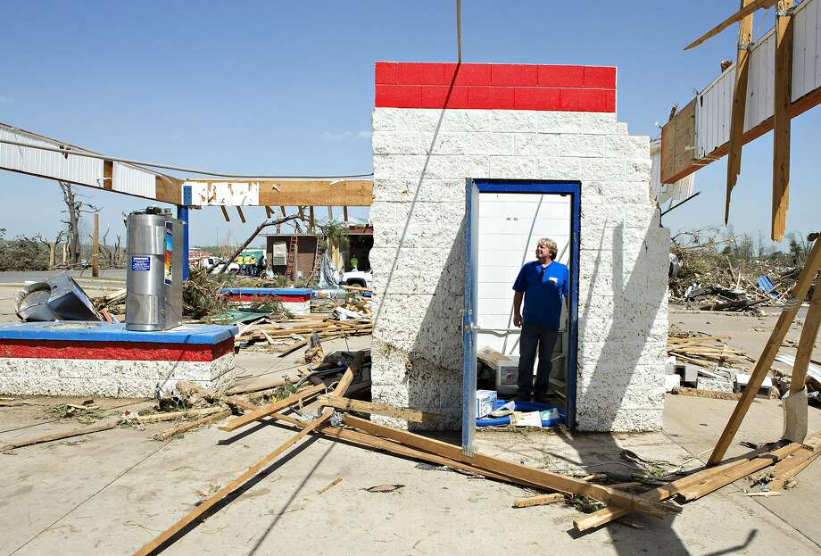 Ken Sullivan, general manager of We Willies Super Auto Wash, looks over the damage after a tornado yesterday tore through the area for the second time in three years, on April 28, 2014 in Vilonia, Arkansas. After deadly tornadoes ripped through the region, leaving more than a dozen dead, Mississippi, Arkansas, Texas, Louisiana and Tennessee are all under watch as multiple storms over the next few days are expected.  Photo: Wesley Hitt, Getty Images