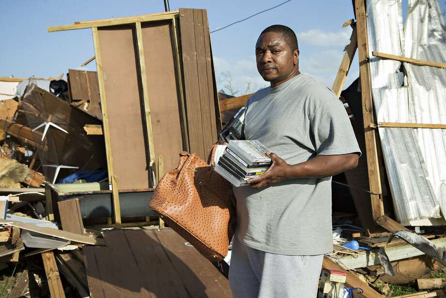 James Guiden looks through what is left of his house after a tornado yesterday tore through the area for the second time in three years, on April 28, 2014 in Mayflower, Arkansas. Guiden and his wife survived by taking shelter in the home's green bath tub. After deadly tornadoes ripped through the region leaving more than a dozen dead, Mississippi, Arkansas, Texas, Louisiana and Tennessee are all under watch as multiple storms over the next few days are expected.  Photo: Wesley Hitt, Getty Images