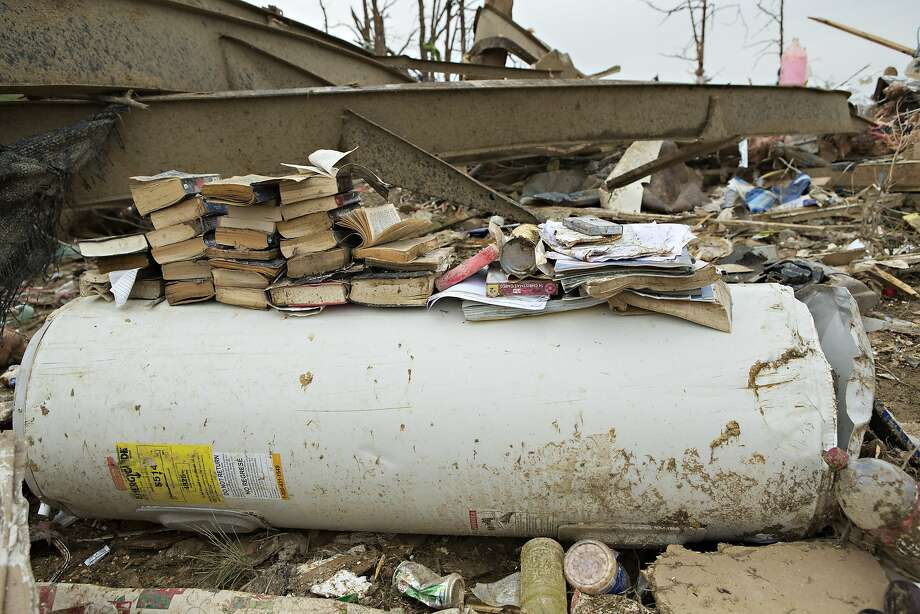 Books are stacked on a water heater after a strong tornado went through the area on April 27 for the second time in three years on April 28, 2014 in Vilonia, Arkansas. After deadly tornadoes ripped through the area and have left over a dozen dead, Mississippi, Arkansas, Texas, Louisiana, and Tennessee are all under watch as multiple storms over the next few days are expected.  Photo: Wesley Hitt, Getty Images