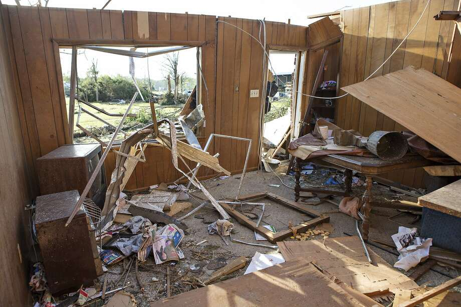 The living room of a house destroyed by a tornado yesterday that tore through the area for the second time in three years is shown, on April 28, 2014 in Mayflower, Arkansas. After deadly tornadoes ripped through the region leaving more than a dozen dead, Mississippi, Arkansas, Texas, Louisiana and Tennessee are all under watch as multiple storms over the next few days are expected.  Photo: Wesley Hitt, Getty Images