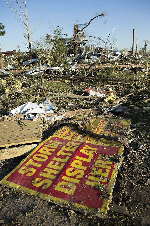 Debris from a house destroyed by a tornado yesterday that tore through the area for the second time in three years is shown, on April 28, 2014 in Mayflower, Arkansas. After deadly tornadoes ripped through the region leaving more than a dozen dead, Mississippi, Arkansas, Texas, Louisiana and Tennessee are all under watch as multiple storms over the next few days are expected. Photo: Wesley Hitt, Getty Images