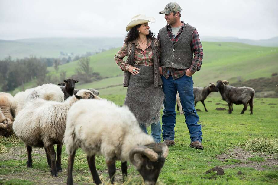 Ariana Strozzi and Casey Mazzucchi with their flock. The couple founded Valley Ford Wool Mill in 2013 to create and promote locally grown bedding and clothing. Photo: Paige Green Photography