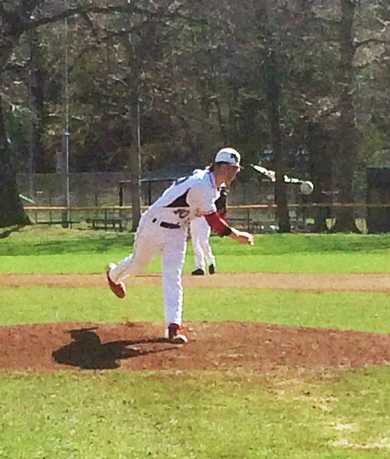 New Canaan starter Dan Rajkowski fires a pitch in against Ridgefield at Mead Park on Monday, April 28. Photo: Andrew Callahan / New Canaan News
