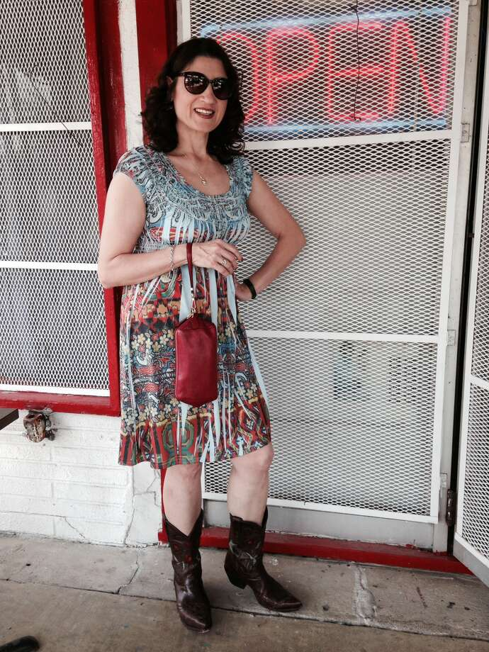Jen Negreteis cowgirl chic in a mash-up summer print dress with a ribbon motif and accessorizes with red rose embossed boots and a wristlet bag. -Michael Quintanilla Photo: Photo By Michael Quintanilla / San Antonio Express-News