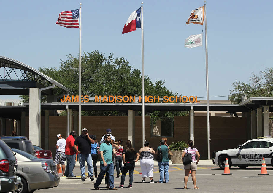 "Parents wait in front of Madison High School Tuesday April 29, 2014 during what is being called a ""soft lockdown."" A student was caught yesterday at the school with weapons. Photo: JOHN DAVENPORT, San Antonio Express-News / ©San Antonio Express-News/John Davenport"