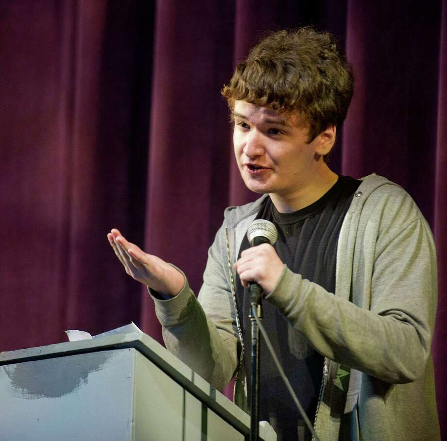 Sam Aldershof of Stamford High School debates the question of whether the federal government should restrict the use of water at Westhill High School as part of the school's production of Urinetown, a satire about the topic, on Tuesday, April 29, 2014. Photo: Lindsay Perry / Stamford Advocate