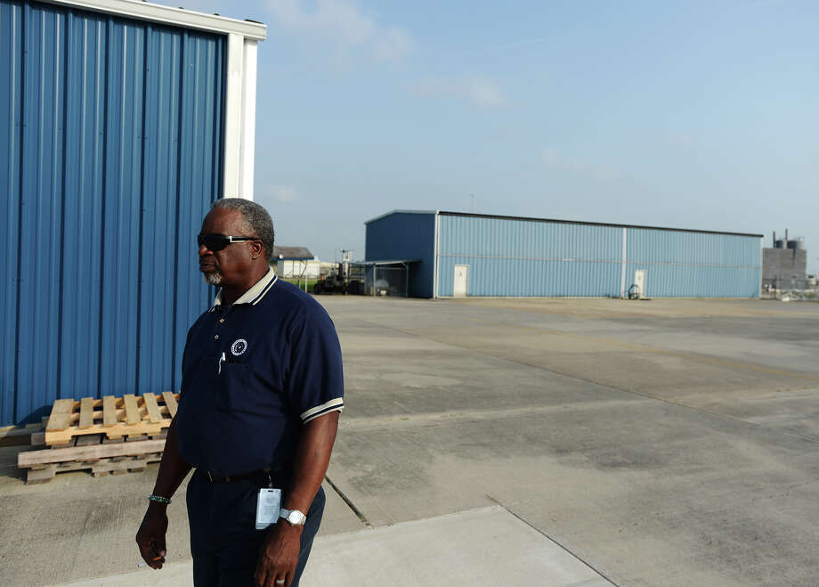 Walter Poole stands near the airplane hangers at the Jefferson County Mosquito Control Division on Monday afternoon. Division workers began training and preparing equipment last week, but strong winds kept employees from spraying for mosquitoes until Monday night. Director Kevin Sexton said that our cold winter led to a slow start to the mosquito season. Sexton, however, noted that an El Nino predicted for this summer could create a moist climate. That means the potential for more summer mosquitoes. Residents can request the agency spray ahead of parties and family gatherings by phone (409-719-5940) or online (http://www.co.jefferson.tx.us/jcmcd). Photo taken Monday, 4/28/14 Jake Daniels/@JakeD_in_SETX Photo: Jake Daniels / ©2014 The Beaumont Enterprise/Jake Daniels
