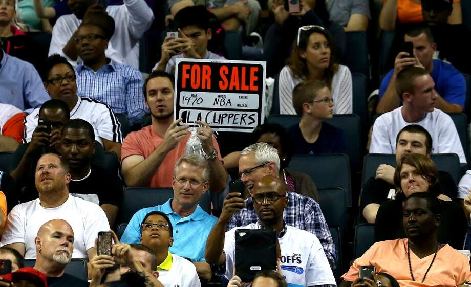 A fan holds a sign in protest of Los Angeles Clippers owner Donald Sterling in Game Four of the Eastern Conference Quarterfinals during the 2014 NBA Playoffs at Time Warner Cable Arena on April 28, 2014 in Charlotte, North Carolina. Photo: Streeter Lecka, Getty Images