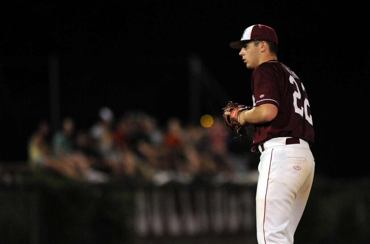 Magnolia sophomore pitcher Blake Helmer works to a Montgomery hitter during their game at Magnolia High School.