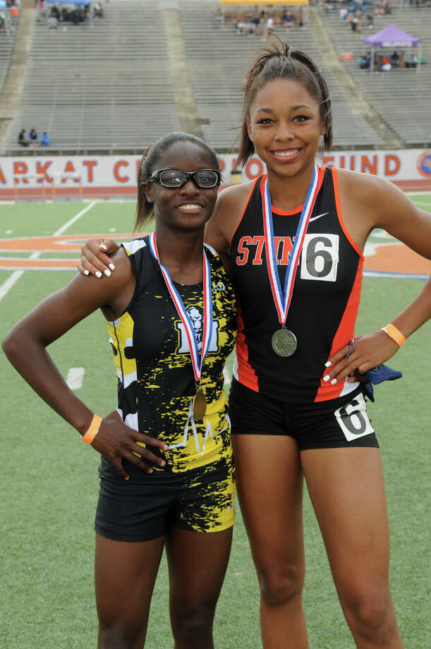 Texas City junior Asa Garcia, right, and FB Marshall junior Joi Gill finished 2nd and 3rd respectively in the Girls 200 Meter Dash at the 2014 Region III-4A Track & Field Championship at Bowers Stadium on the campus of Sam Houston State University in Huntsville on Saturday. Photo: Jerry Baker, Freelance