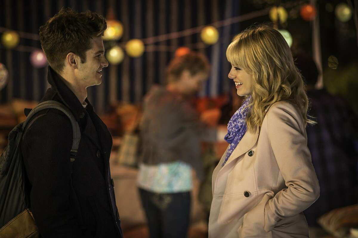 """This image released by Sony Pictures shows Andrew Garfield and Emma Stone in """"The Amazing Spider-Man 2."""" (AP Photo/Columbia Pictures - Sony Pictures, Niko Tavernise)"""
