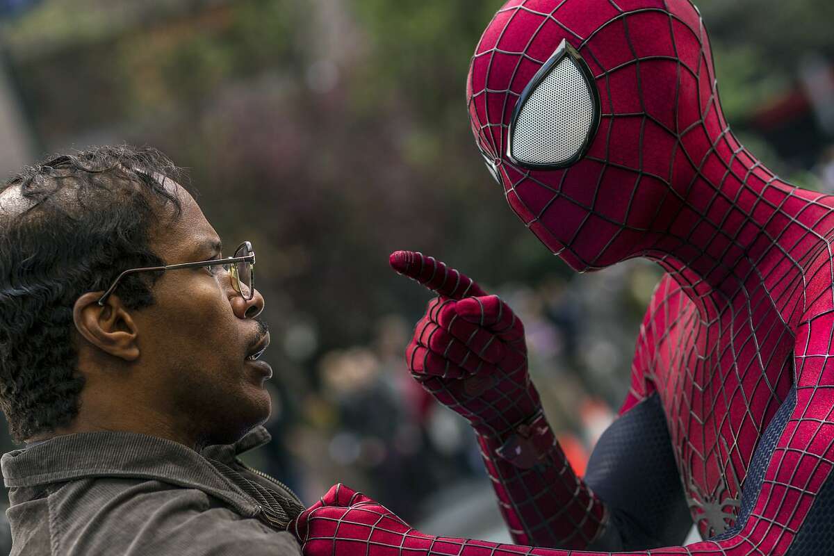 """This image released by Sony Pictures shows Jamie Foxx, left, and Andrew Garfield as Spider-Man in """"The Amazing Spider-Man 2."""""""