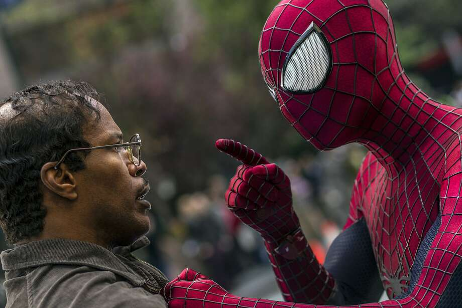"""This image released by Sony Pictures shows Jamie Foxx, left, and Andrew Garfield as Spider-Man in """"The Amazing Spider-Man 2."""" Photo: Niko Tavernise, Associated Press"""