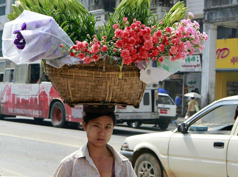Mother's Day is right around the corner:A floral vendor makes a delivery in Yangon, Myanmar. Photo: Khin Maung Win, Associated Press
