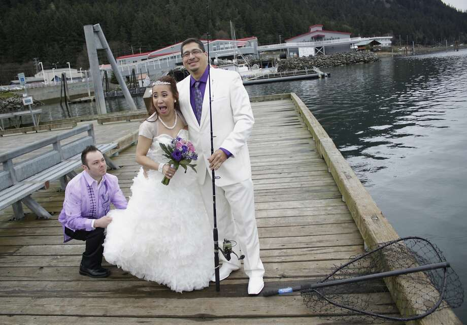 What a catch!Annie Lazo and Arthur Chappell prepare for their wedding photo shoot at the   Channel Wayside Fishing Dock on Gastineau Channel in Juneau, Alaska. Arthur proposed to   Annie while they were fishing together. Photo: James Brooks, Associated Press