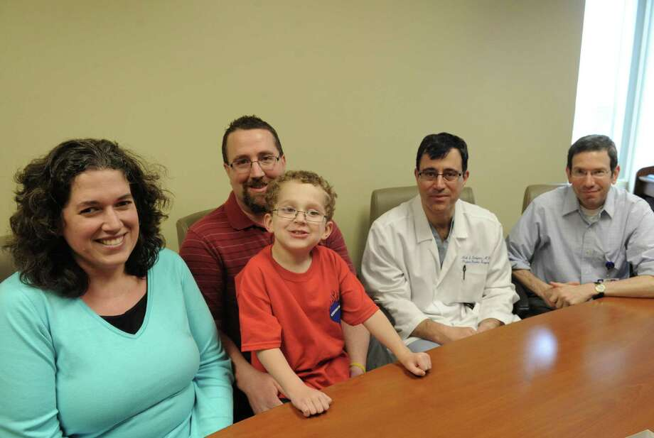 Patrick Buffaline, 4, who has undergone open heart surgery, with his parents Patricia and Kevin Buffaline  and his doctors Neil Devejian and Steve Kamenir, right,on Wednesday April 23, 2014 in Albany, N.Y. (Michael P. Farrell/Times Union) Photo: Michael P. Farrell / 00026600A
