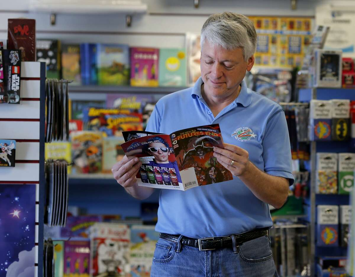 Joe Field looks over one of the comics that will be given away on Free Comic Books Day in Concord, Calif. Joe Field is the owner of Flying Colors Comics where they are celebrating their 25th anniversary in Concord, Calif. Field co-founded the original WonderCon and also started Free Comic Books Day which is happening May 5.