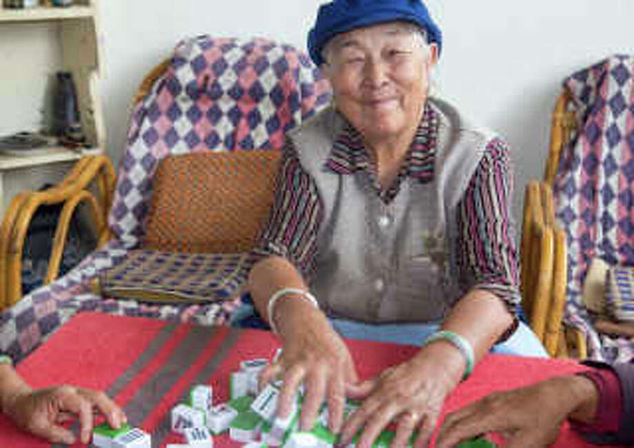"""Grandma Plays Mahjong"" by Westporter Bernard Perry is a winning photograph on display in ""Images 2014,"" a photo exhibit at the Fairfield Museum and History Center in Fairfield. Photo: Contributed Photo / Westport News"