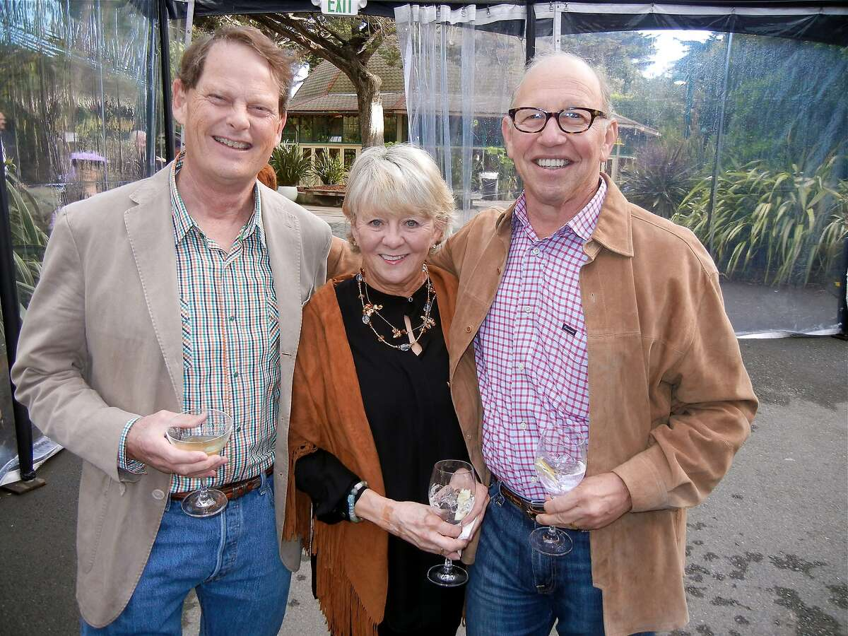 Dr. Bill Andereck (left) with Cathy Dinovitz and her husband, Hearst Foundations Director Paul Dinovitz at the ZooFest. April 2014. By Catherine Bigelow.