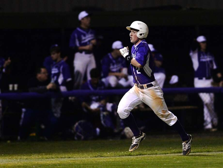 Port Neches-Groves' Skylar Finn, No. 2, heads for home during Friday's game against Little Cypress-Mauriceville. The Little Cypress-Mauriceville baseball team played against Port Neches-Groves at Port Neches-Groves on Friday. Photo taken Friday, 3/14/14 Jake Daniels/@JakeD_in_SETX
