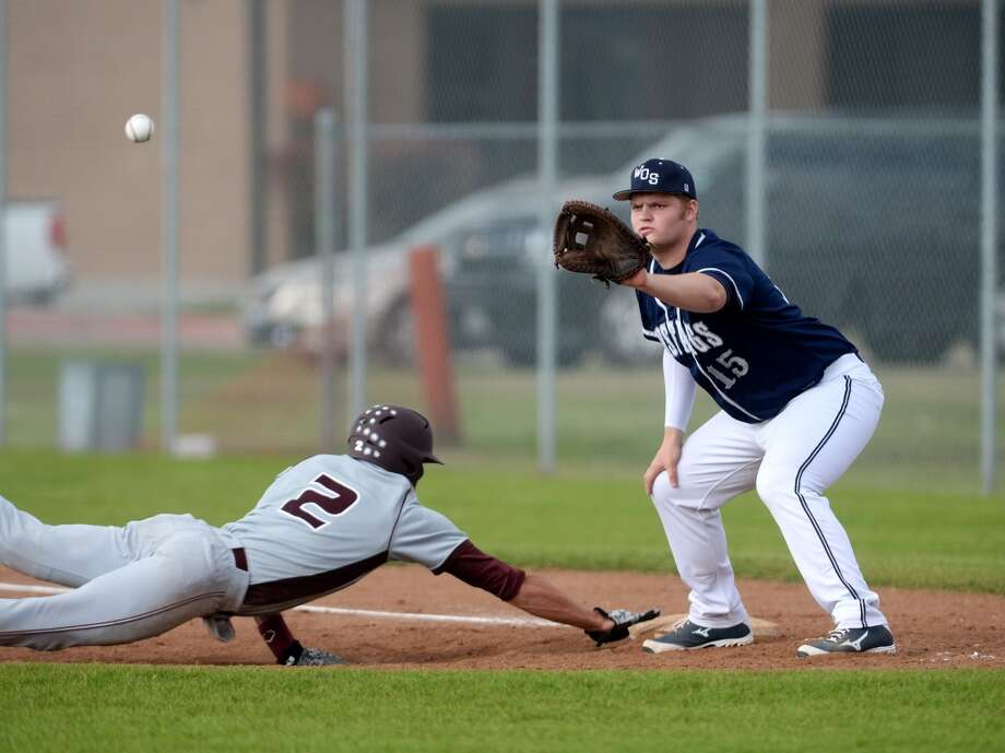 Silsbee's Kris Elers, No. 2, races the ball back to first base while West Orange-Stark's Jacob Hryhorchuk, No. 15, readies to out him Monday. The West Orange-Stark High School baseball team played against Silsbee at West Orange-Stark on Monday afternoon. Photo taken Monday, 3/31/14 Jake Daniels/@JakeD_in_SETX