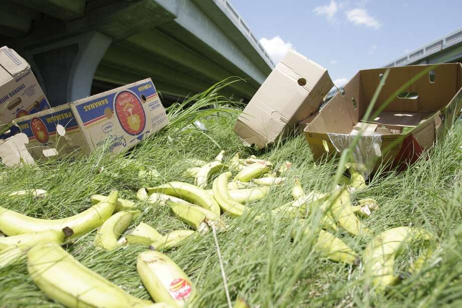 Bananas and plantains lay on the ground below where an 18-wheeler overturned on the elevated potion of the 59 northbound ramp from I-10 eastbound and lost part its load of bananas and plantains Monday, Aug. 27, 2012, in Houston. ( Melissa Phillip / Houston Chronicle ) Photo: Melissa Phillip, Houston Chronicle