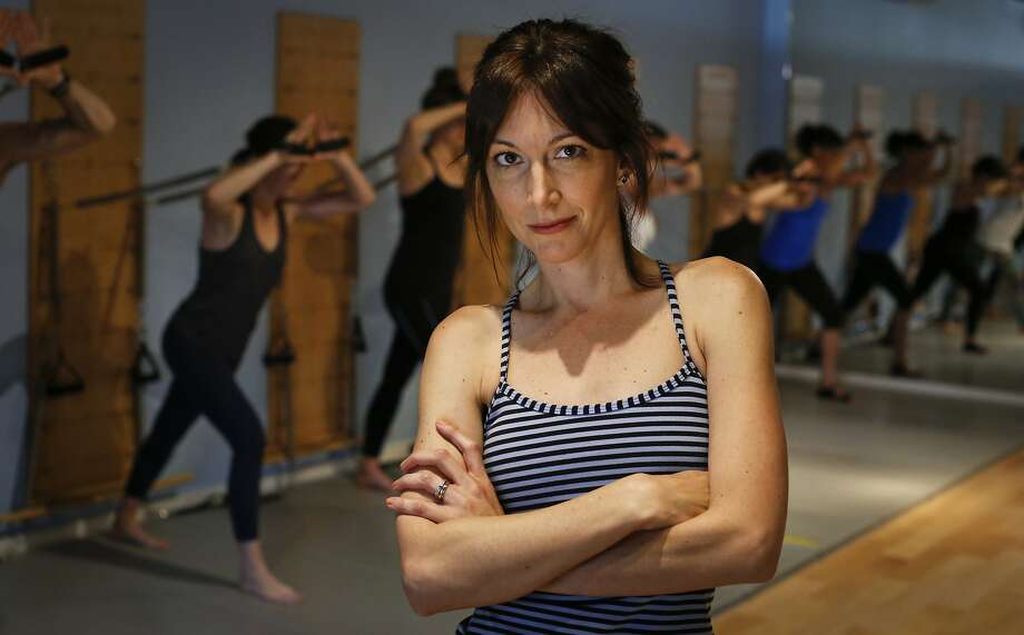 Lisa Corsello, at Burn on Broadway in S.F., offers exercises modified for pregnant clients. Corsello, who has two children, also hosts the Burn Pregnancy and Fitness Seminar. Photo: Russell Yip, The Chronicle