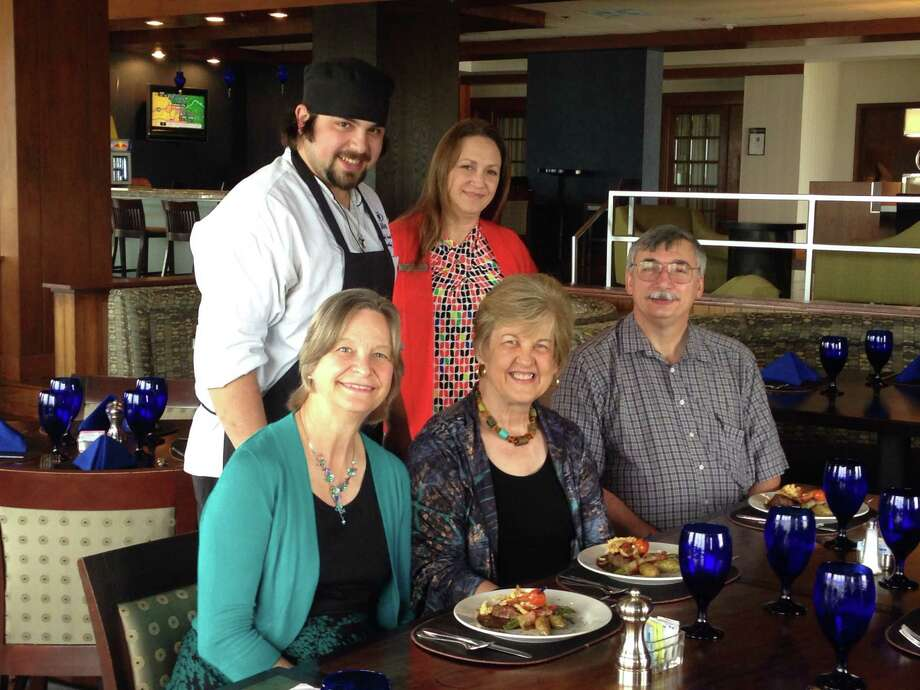 """The Clear Lake Area Symphony Society staged a preview tasting for its """"Great Chefs of the Bay Area."""" Participants included, from left, standing: Hilton Executive Chef Kody Hayward and food/beverage director Laura Trigot; seated: Clear Lake Symphony cellist Karen Akkerman, Clear Lake Symphony fundraising director Sherrie Matula and her husband David Matula, Clear Lake Symphony webmaster. The Matulas are event co-chairs.    The Clear Lake Area Symphony Society staged a preview tasting for its """"Great Chefs of the Bay Area."""" Participants included, from left, standing: Hilton Executive Chef Kody Hayward and food/beverage director Laura Trigot; seated: Clear Lake Symphony cellist Karen Akkerman, Clear Lake Symphony fundraising director Sherrie Matula and her husband David Matula, Clear Lake Symphony webmaster. The Matulas are event co-chairs. Photo: Matt Walker / For The Chronicle"""