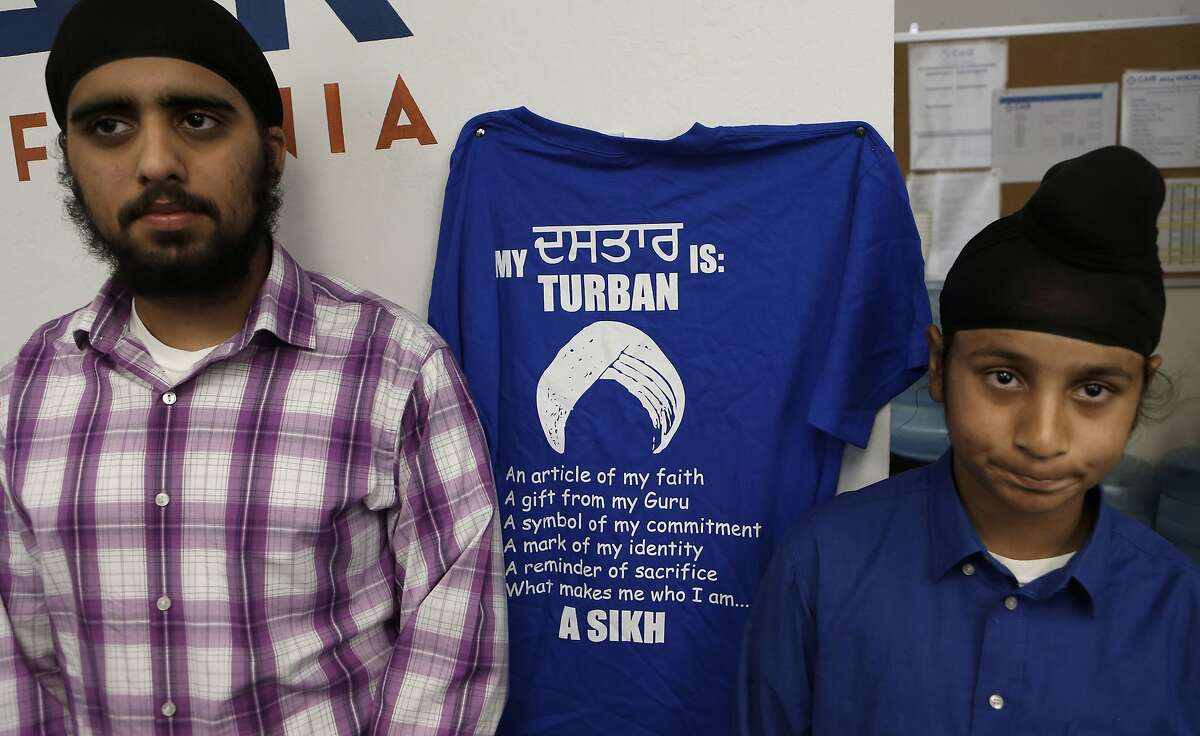 16-year-old Diljit Singh Bains, (left) and his brother Jaskirat Singh Bains during a press conference at the offices of the Council on American-Islamic Relations in Santa Clara, on Tuesday April 29, 2014, were denied rides on the go-karts, in July of 2013, because they wore headwear. United Sikhs is demanding a policy change from amusement park Boomers! to allow followers of the Sikh religion, Muslim and other faiths to wear their required religious headwear while riding the park's go-karts.
