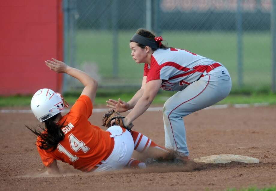 Orangefield's Katelyn Dickerson, No. 14, is outed on her slide into second by Bridge City's Hannah Carpenter, No. 7, during Monday's game. The Orangefield High School softball team played against Bridge City at Orangefield on Monday afternoon. Photo taken Monday, 3/31/14 Jake Daniels/@JakeD_in_SETX