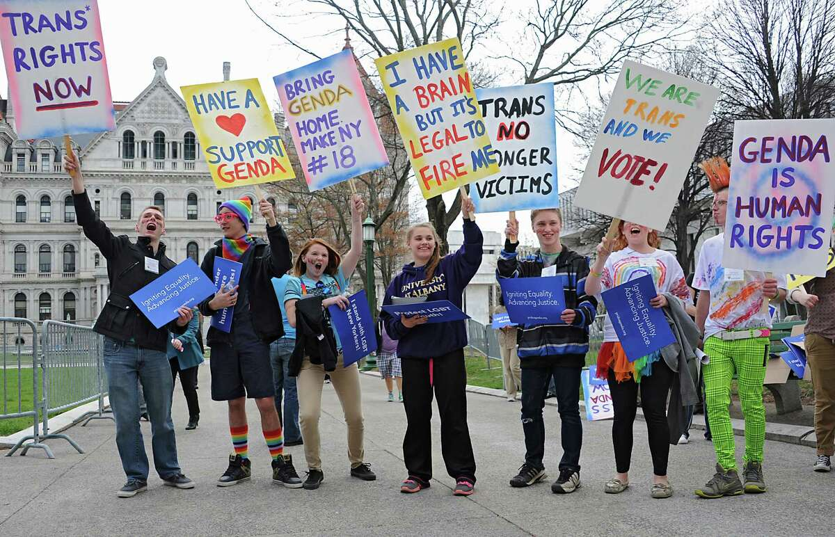 People hold signs as they participate in the New York LGBT Equality & Justice Day 2014 rally hosted by Empire State Pride Agenda Tuesday, April 29, 2014, at the Capitol in Albany, N.Y (Lori Van Buren / Times Union)