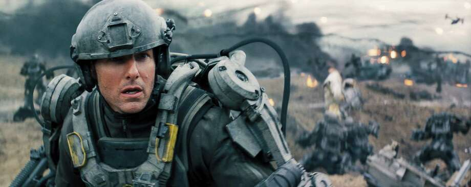 "Tom Cruise stars in ""Edge of Tomorrow. "" Time travel, laser fights and lots of explosions give Cruise a good action-guy vehicle. Photo: Warner Bros. / (c) 2013 Warner Bros. Entertainment Inc.- U.S., Canada, Bahamas & Bermuda (c) 2013 Village Roadshow Films (BVI) Limited- All Oth"