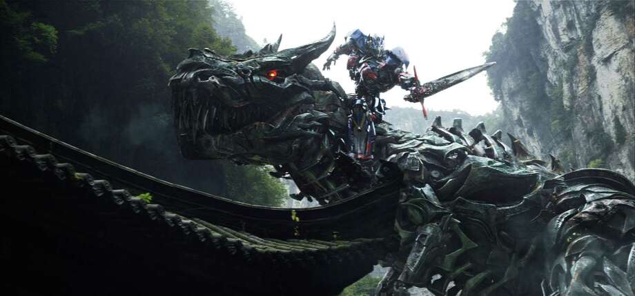 "This image released by Paramount Pictures shows Grimlock and Optimus Prime in ""Transformers: Age of Extinction."" Photo: Associated Press / Paramount Pictures"
