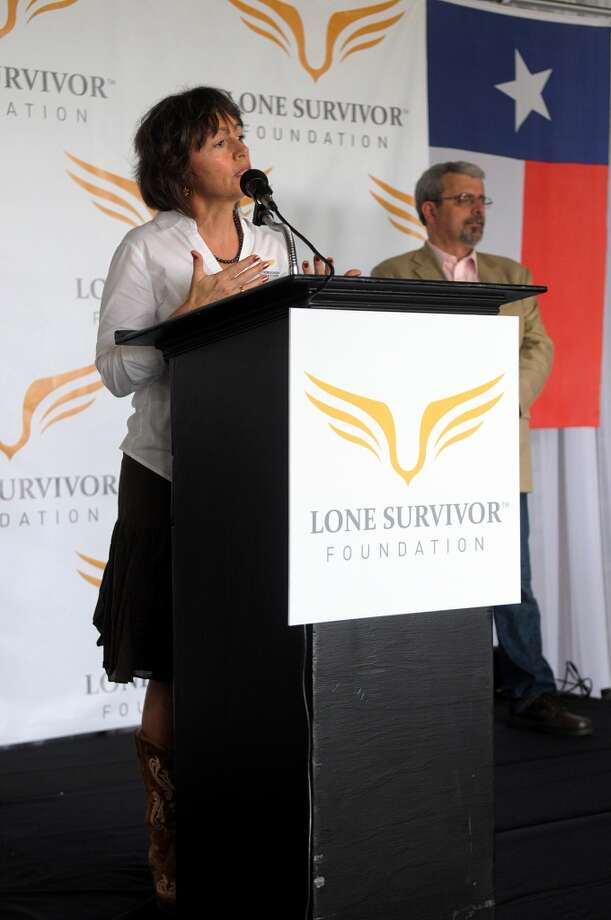 Denise Grant, Program Manager for the Lone Survivor Foundation Crystal Beach Retreat Facility, speaks during the groundbreaking ceremony on Saturday (April 26). Photo: Jerry Baker, For The Chronicle