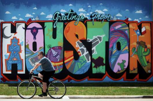 This mural is painted on the side of an upcoming gelato place called Gelazzi in the Heights which is due to open in May.Keep clicking to see more public art that is keeping Houston colorful. Photo: Mayra Beltran, Houston Chronicle / © 2014 Houston Chronicle