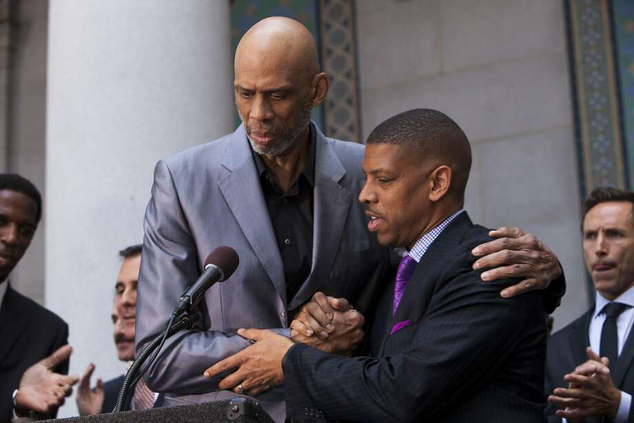 Basketball Hall of Famer Kareem Abdul-Jabbar (left) and Sacramento Mayor Kevin Johnson meet with the media outside Los Angeles City Hall, where they praised the action taken by NBA Commissioner Adam Silver. Photo: Ted Soqui, Ted Soqui For The Chronicle