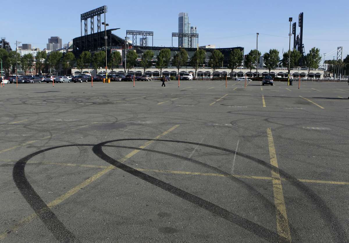 Skid marks are left in parking Lot A, across from AT&T Park in San Francisco, Calif. on Tuesday, April 29, 2014. The Giants are proposing to build a large mixed-use community on the site, but the plans may be derailed if Prop. B, which would impose height limits on waterfront developments, is passed by voters.