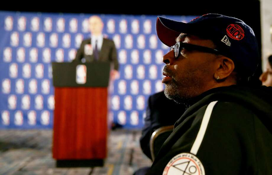 Spike Lee, a longtime visible Knicks fan, listens to NBA Commissioner Adam Silver discuss punishment for Clippers owner Donald Sterling in New York. Photo: Elsa, Getty Images