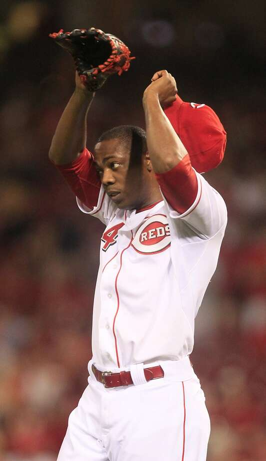 Cincinnati Reds relief pitcher Aroldis Chapman wipes his face during a baseball game against the Houston Astros, Friday, Sept. 7, 2012, in Cincinnati. (AP Photo/Al Behrman) Photo: Al Behrman, Associated Press