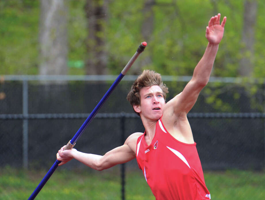 Taylor Moore of Greenwich High School throws the javelin during the high school track meet at Greenwich High School, Tuesday, April 29, 2014. Photo: Bob Luckey / Greenwich Time