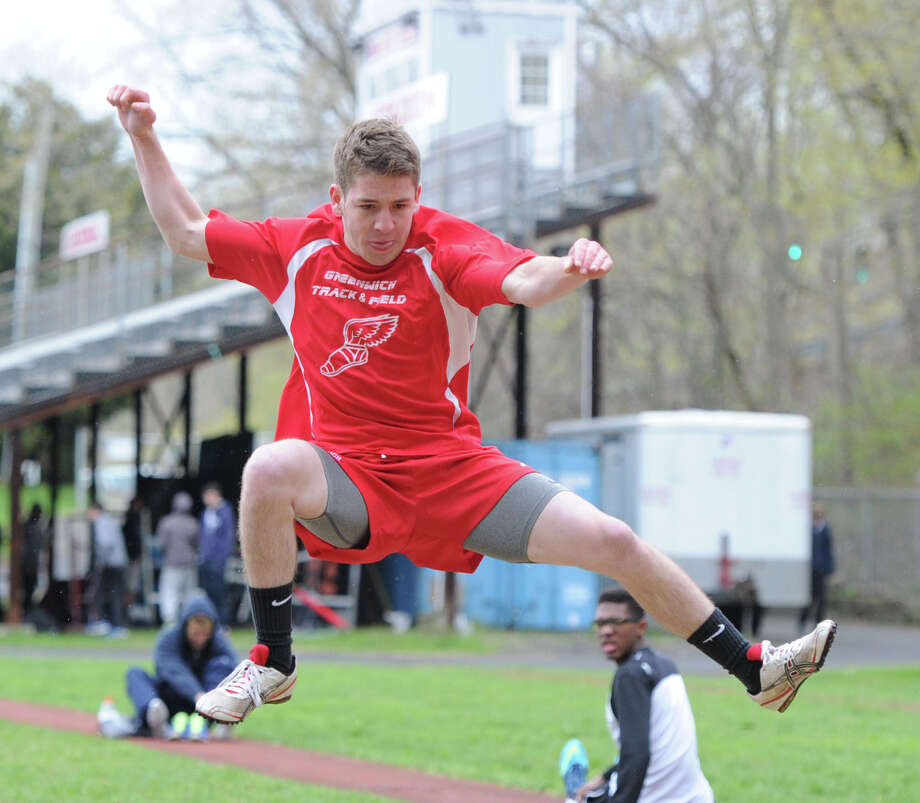 Greenwich High School's James Duffy competes in the long jump during the high school track meet at Greenwich High School, Tuesday, April 29, 2014. Photo: Bob Luckey / Greenwich Time