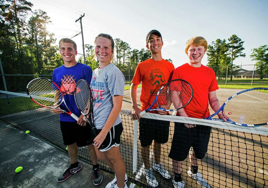 Kountze High School tennis players Blake Best, Madison Read, Drew Anderson, and Landry Linn, left to right, pose for a picture days before heading to the state tournament in College Station.  Anderson and Linn won the state championship in boys doubles. Jake Daniels/@JakeD_in_SETX Photo: Jake Daniels / ©2014 The Beaumont Enterprise/Jake Daniels