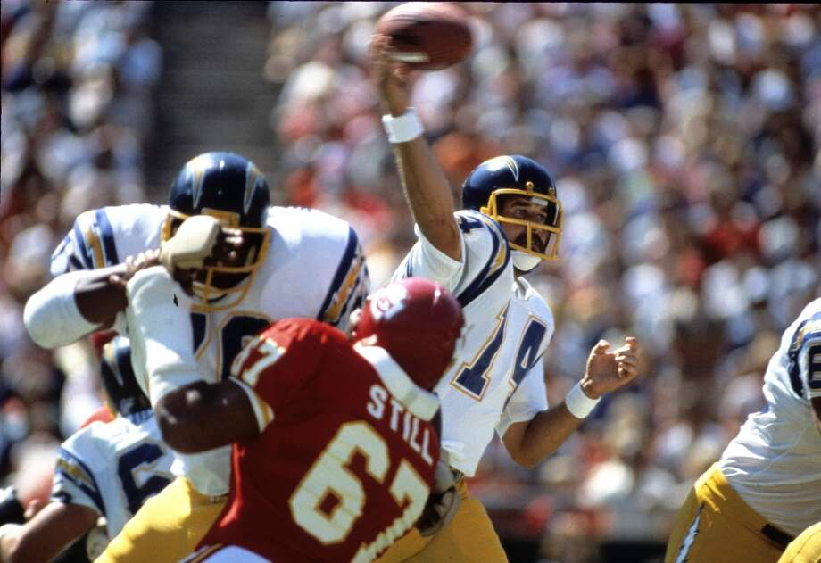"Pick No. 64 | 1973 | San Diego ChargersDan Fouts | Quarterback | OregonAs the trigger-man in head coach Don Coryell's ""Air Coryell"" offense, Fouts became one of the forerunners of the modern passing game, throwing for over 43,000 yards in his career. The ""Bearded QB"" was a Pro-Bowl selection six times and an AP first-team All-Pro in 1979 and 1982. Fouts was inducted into the Pro Football Hall of Fame in 1993. Photo: Ronald C. Modra/Sports Imagery, Getty Images"
