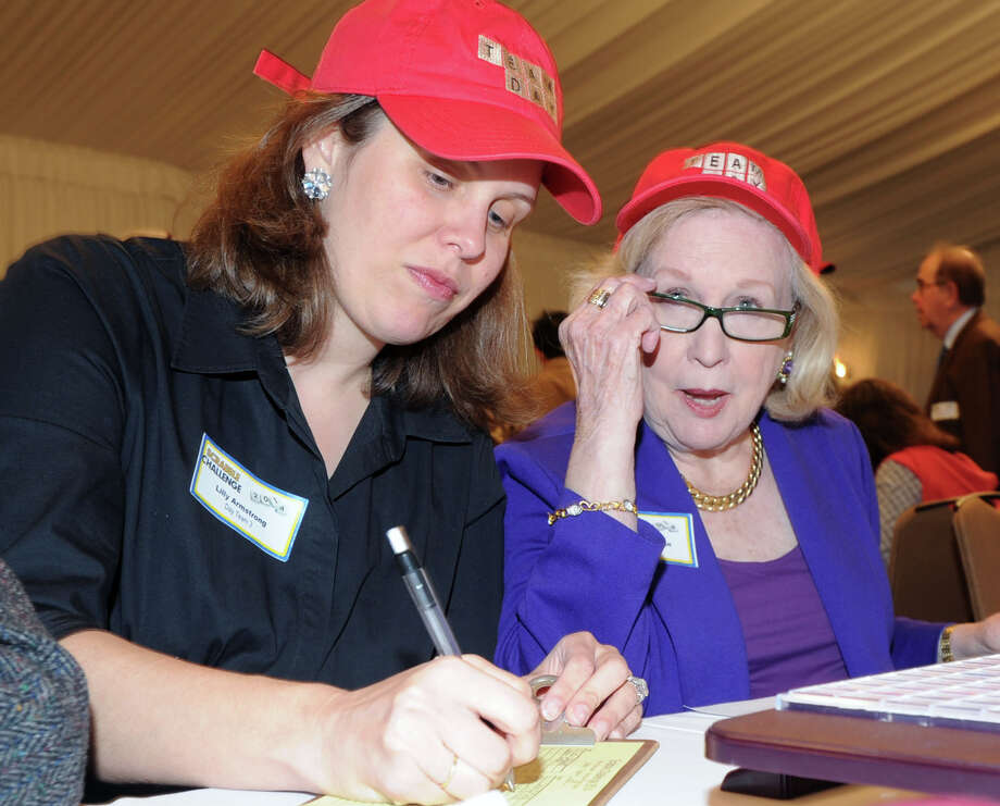At left, Lilly Armstrong and her teammate, Marianne Wyman, both of Greenwich, during the 14th annual Scrabble Challenge to benefit Literacy Volunteers at Greenwich Hyatt Regency, Tuesday night, April 29, 2014. Literacy Volunteers is a program of Family Centers, which offers free literacy, English language instruction and adult education services to more than 500 Fairfield County residents each year. Photo: Bob Luckey / Greenwich Time
