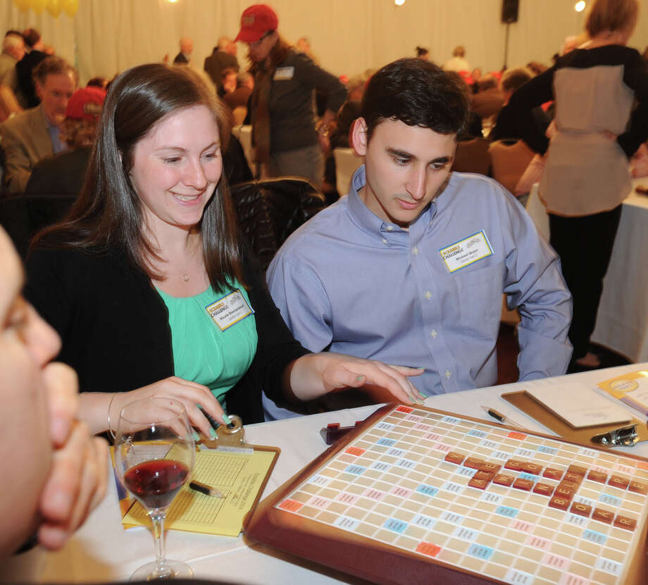 Deloitte team members, Nicole Montambault, left, and Michael Bryan, both of Stamford, during the 14th annual Scrabble Challenge to benefit Literacy Volunteers at Greenwich Hyatt Regency, Tuesday night, April 29, 2014. Literacy Volunteers is a program of Family Centers, which offers free literacy, English language instruction and adult education services to more than 500 Fairfield County residents each year. Photo: Bob Luckey / Greenwich Time