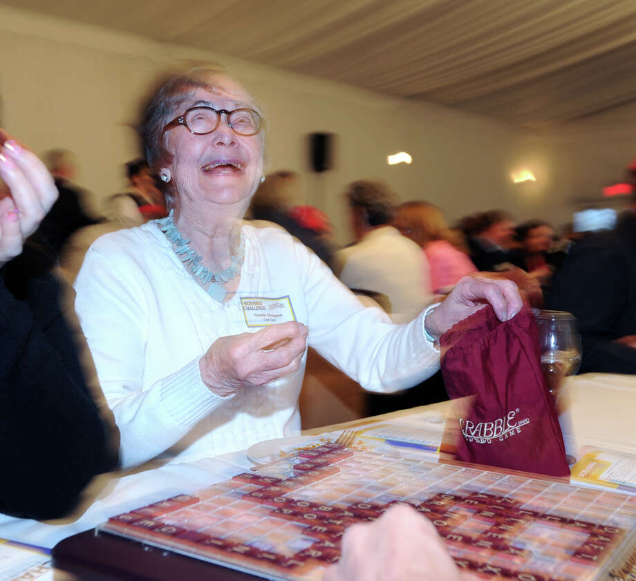 """Stamford resident Connie Sheppard of the """"Cook Team"""" laughs during the 14th annual Scrabble Challenge to benefit Literacy Volunteers at Greenwich Hyatt Regency, Tuesday night, April 29, 2014. Literacy Volunteers is a program of Family Centers, which offers free literacy, English language instruction and adult education services to more than 500 Fairfield County residents each year. Photo: Bob Luckey / Greenwich Time"""